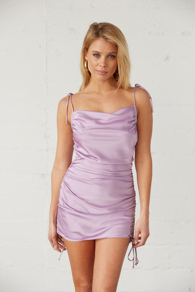 Satin cinched mini dress with side tie details.