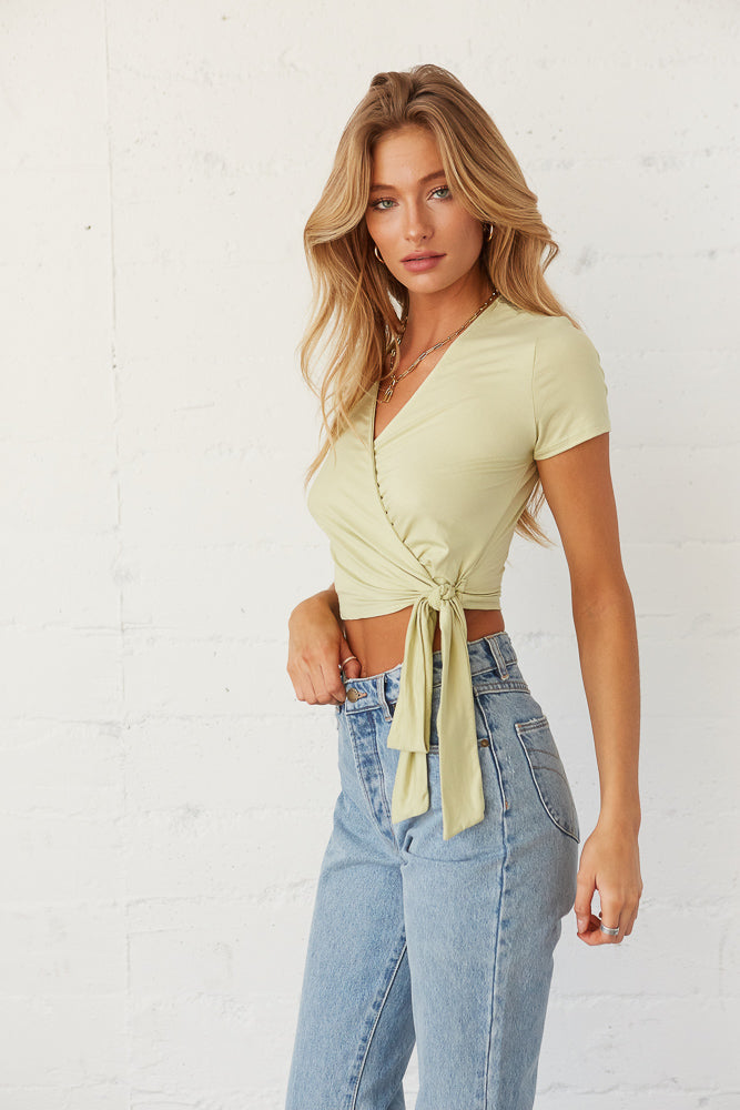 Adjustable tie detail on crop top.