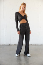 Lounge pants with matching crop top.