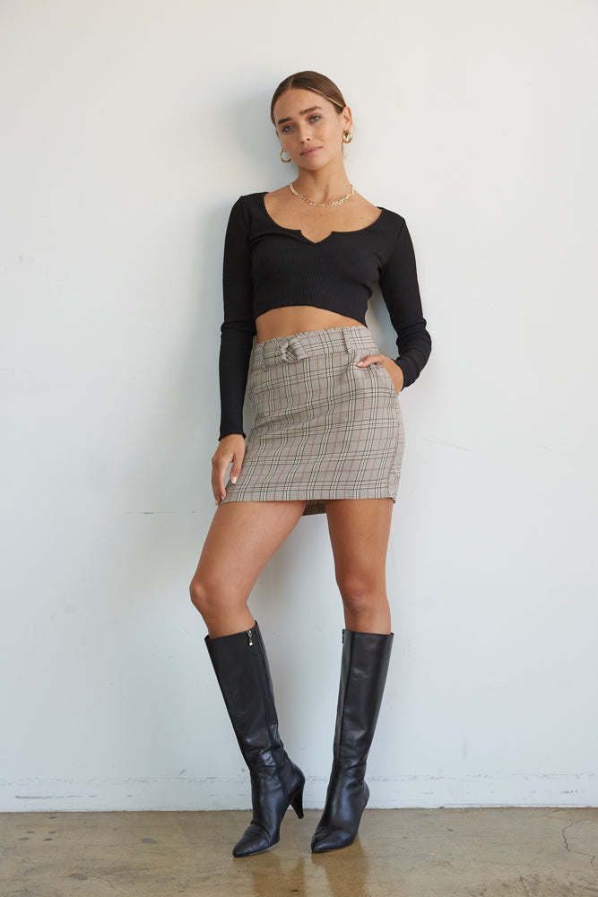This plaid mini skirt is complete with side pockets.