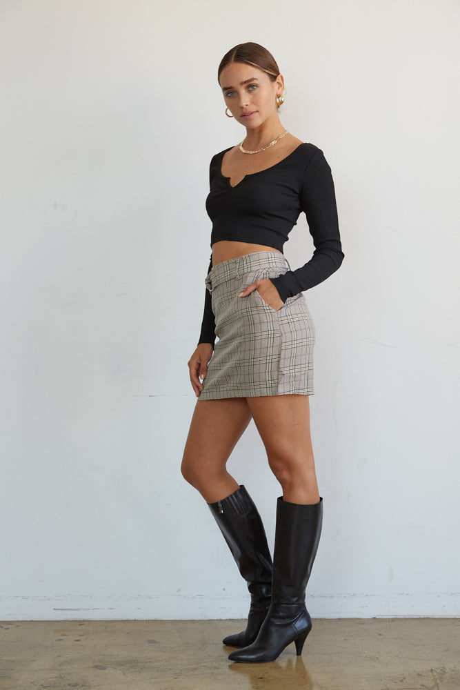 Side details of plaid mini skirt.