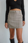 Plaid mini skirt with black crop top.