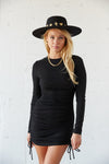 Long sleeve mini dress with a ruched body and side cinching.