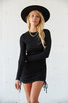 Little black dress with long sleeves and side tie details.