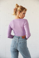 The back of this cropped sweater is simple and ribbed.
