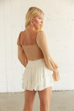 The back of this crop top is smocked for the perfect fit.