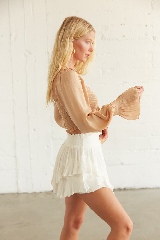 This flowy crop top has long billowy sleeves