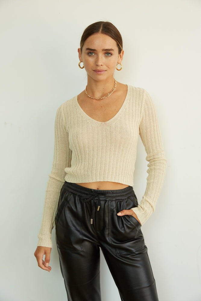Beige ribbed knit sweater top.