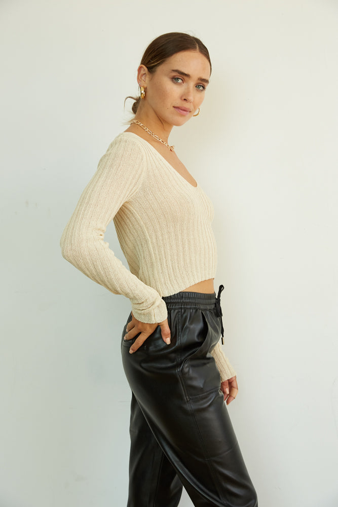 The side of this crop top has long sleeves and a knit design.
