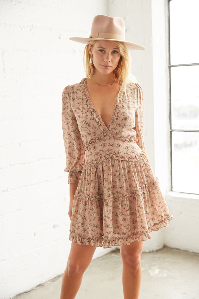 Taupe floral mini dress with ruffle skirt.