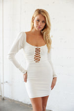 White lace up mini dress with puff shoulders and long sleeves.