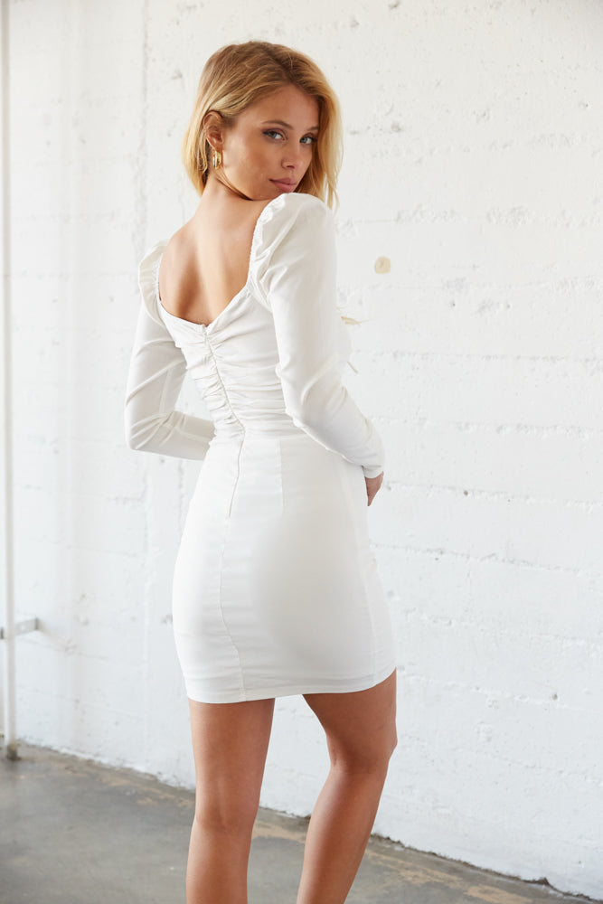 The back of this dress is ruched with a zipper closure.