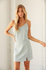 Sage blue mini dress with side slit detail.