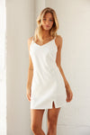 White mini dress with side slit detail.