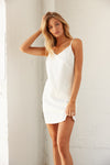 White mini dress with V neckline.