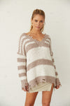 Striped popcorn knit sweater with V neckline.