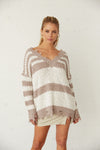 Oversized striped sweater with mocha and white stripes.