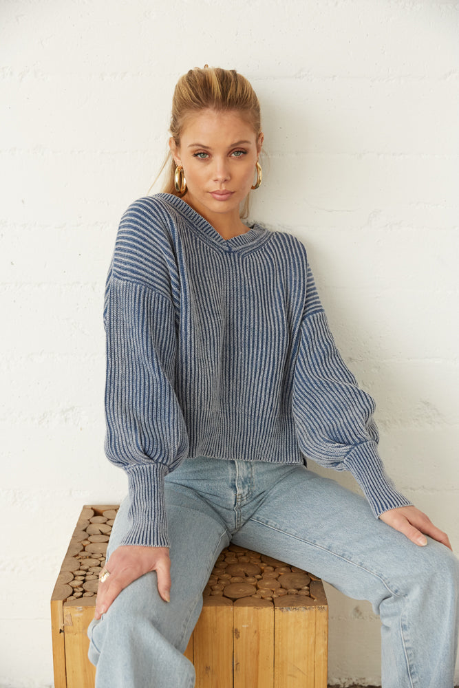 Ribbed chunky sweater with long balloon sleeves.