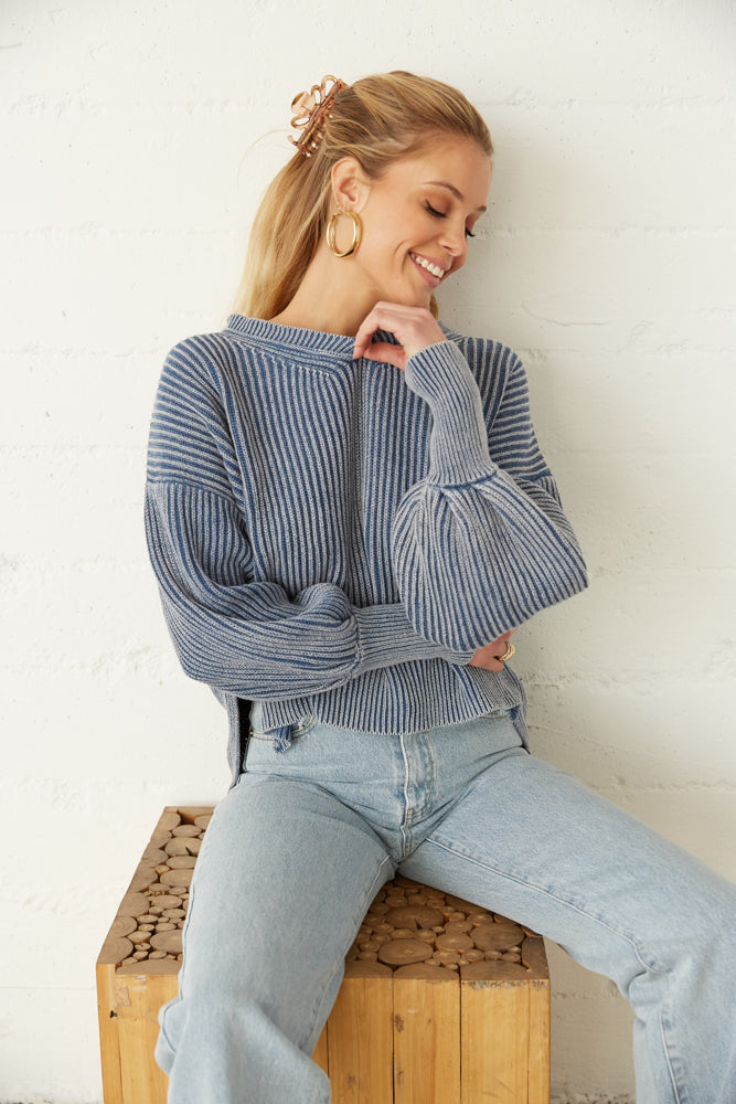 Cute sweater with ribbed armholes.