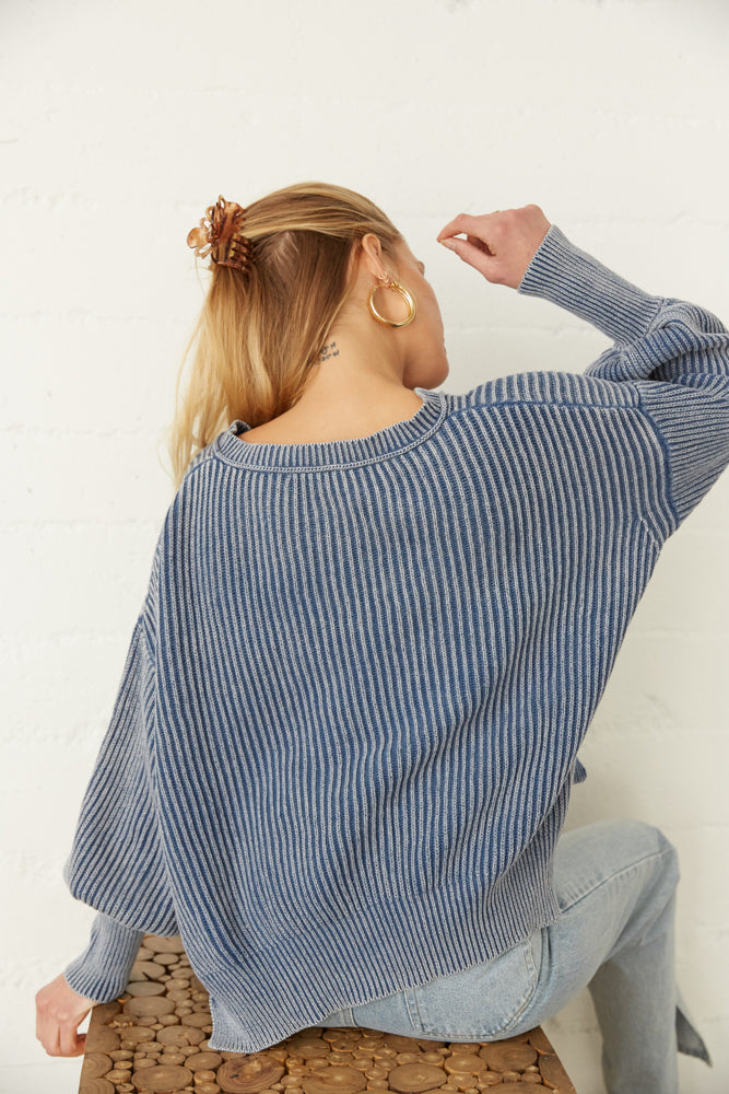 The back of this sweater is relaxed with a ribbed knit design.