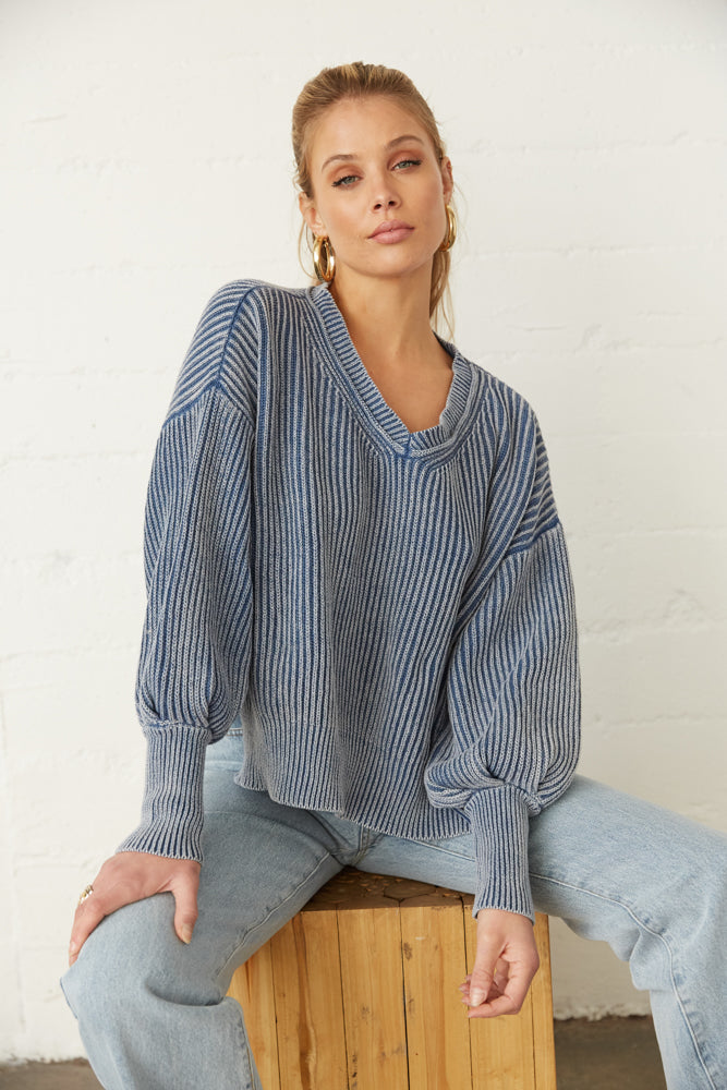 Boxy sweater with ribbed knit design.