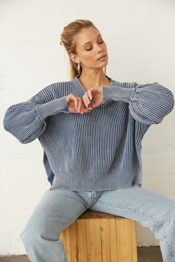 The sweater has slouchy balloon sleeves with ribbed armholes.