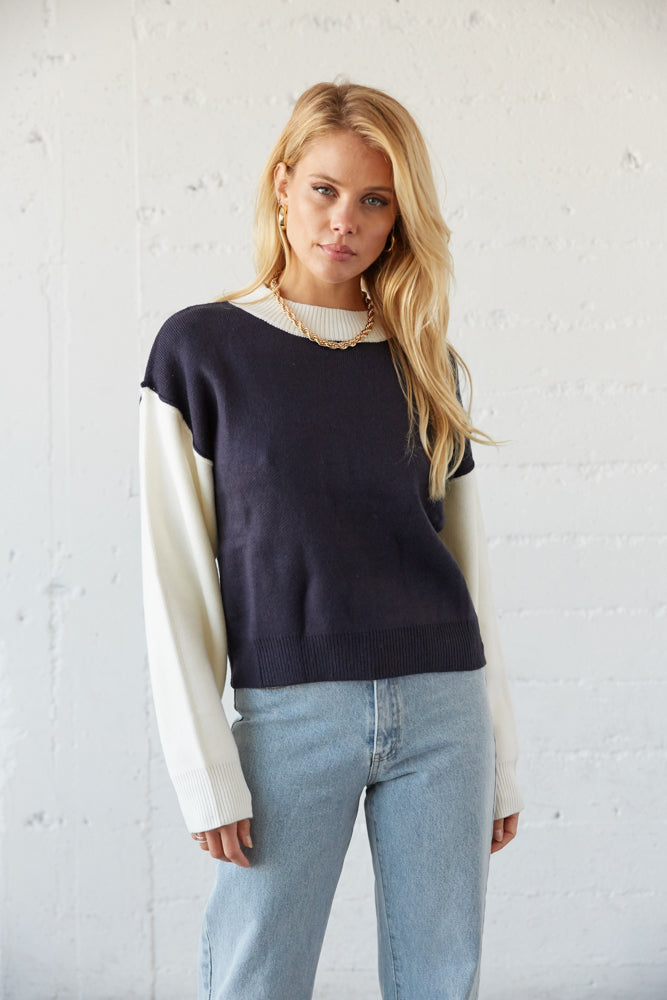 Navy and white color block sweater.