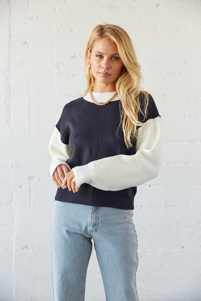 details of the white long sleeves on this sweater.