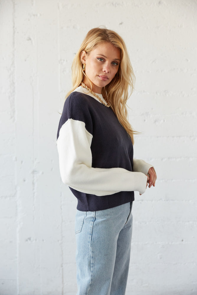 The side of this sweater shows off the white long sleeves.