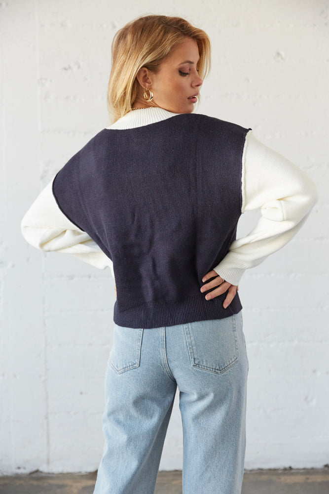 The back of this sweater is relaxed with a ribbed hem.