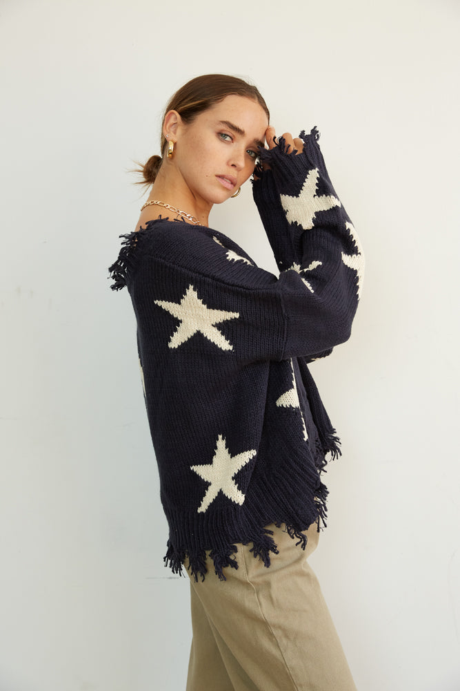 Side of the sweater is relaxed with long slouchy sleeves.
