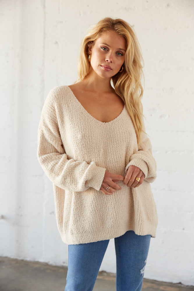 White comfy sweater with slouchy v neckline.