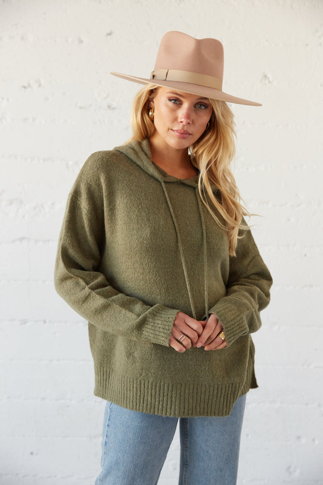 Oversized sweater with attached hood and drawstring tie.