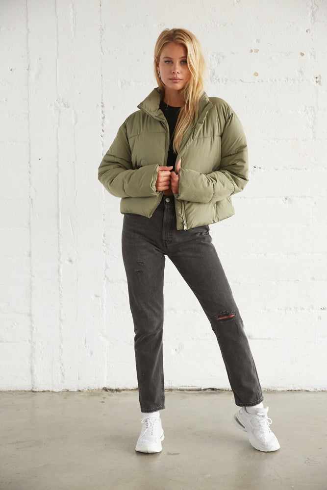 Green puffer jacket with cropped relaxed silhouette.