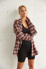 Burgundy flannel with plaid print.