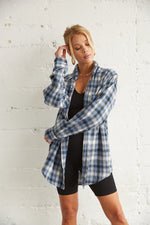 Blue oversized flannel shirt.