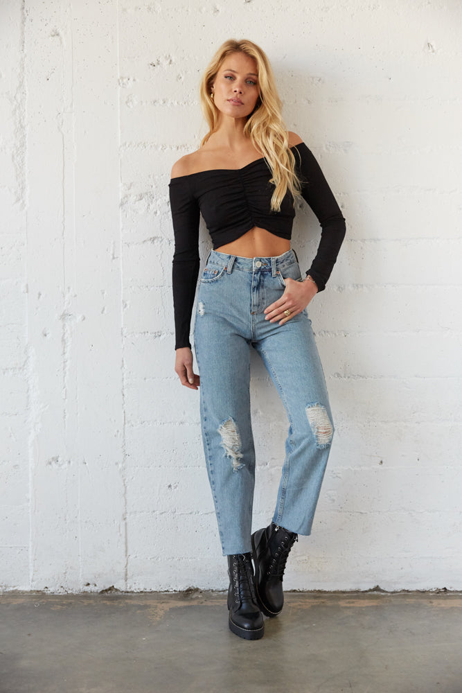 High waisted denim jeans with distressed detailing.