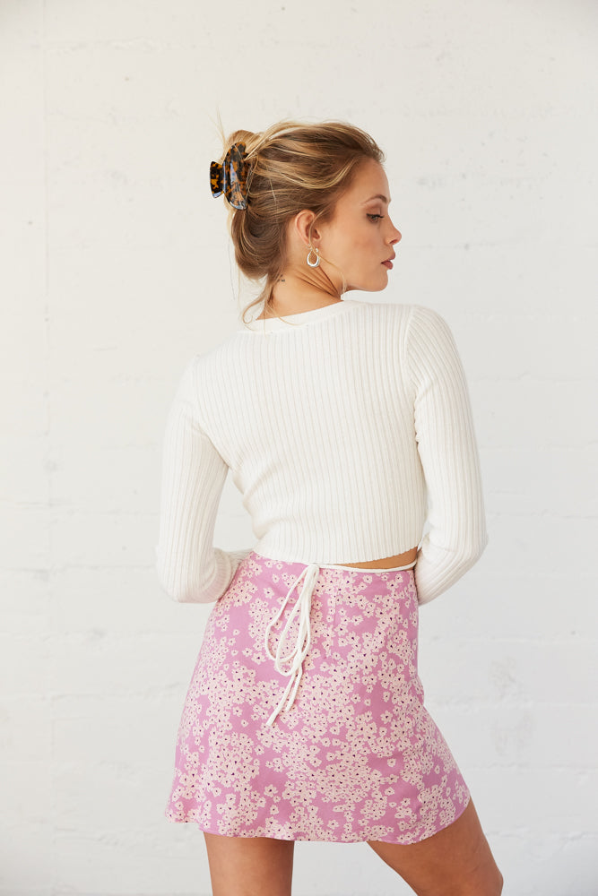 The back of this mini skirt is relaxed.
