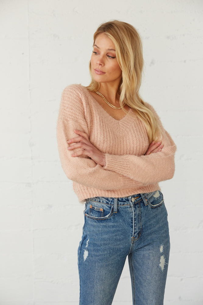This sweater has a V neckline and long sleeves.