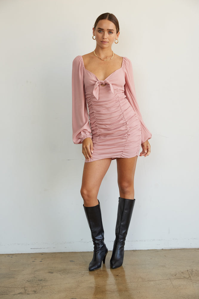 Pink ruched dress with v neckline.