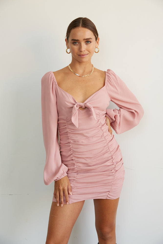 Pink ruched mini tie dress.