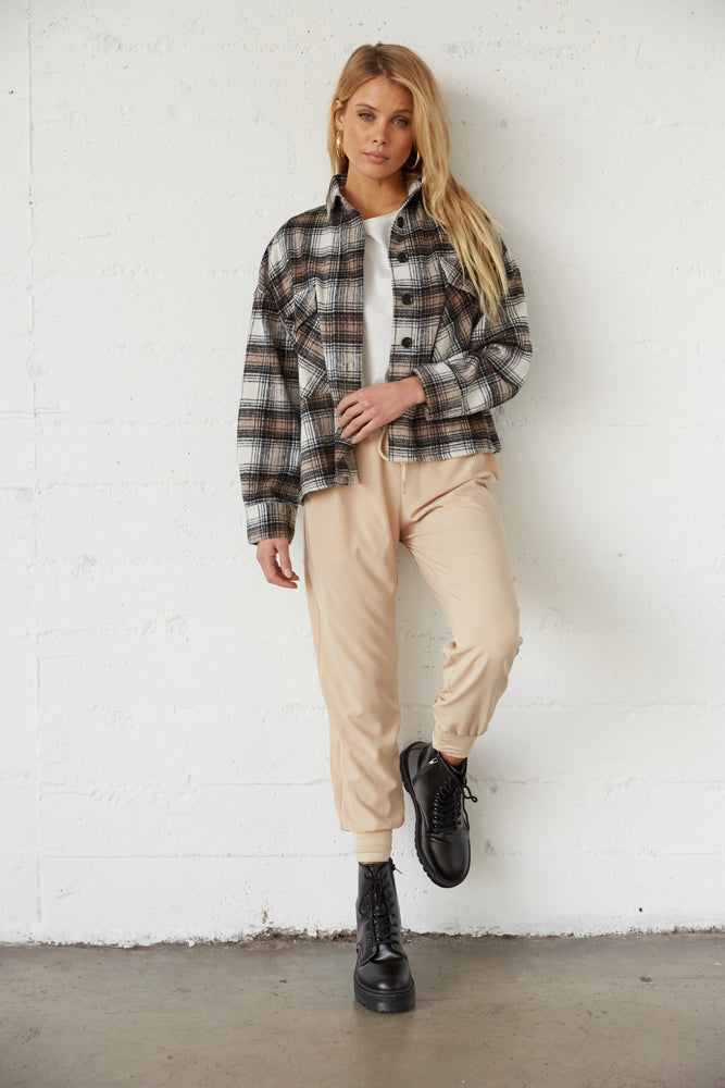 Cropped flannel with tan joggers.