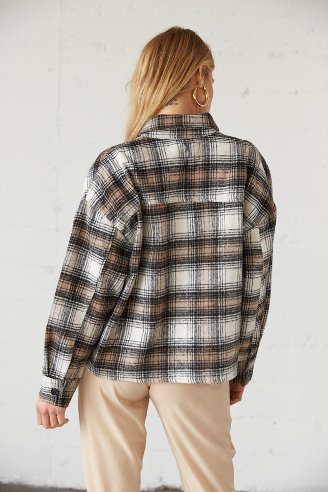 The back of this crop jacket is relaxed and boxy.