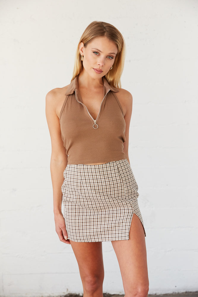 Brown tank top with plaid mini skirt.