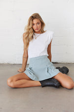 Plaid pleated mini skirt with white tee.