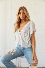 Flutter sleeves on crop top.