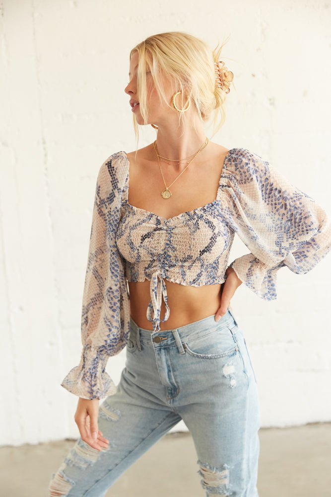 Snakeskin crop top with long sleeves.