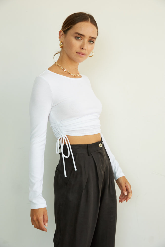 Ribbed crop top with adjustable side cinch detailing.