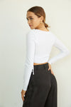The back of this top shows off the cropped silhouette and long sleeves.