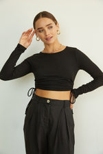Black ribbed crop top with side tie details.